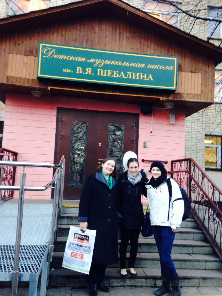With Shebalin's great-granddaughter and great-great-granddaughter, outside the Shebalin Music School in Moscow