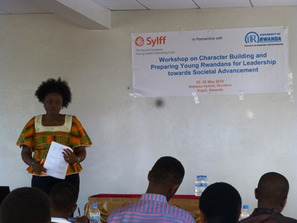 The organizer, Ms. Chika Ezeanya, presents with passion at the workshop on character building and leadership development in Kigali, Rwanda.