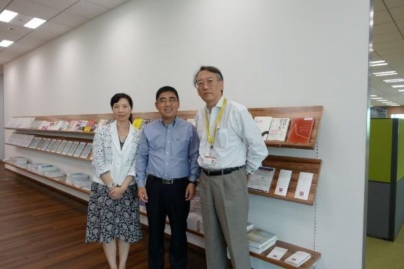Mr. and Mrs. Guo with Senior Fellow Ke Long.